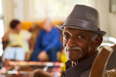 senior man on home looking and smiling